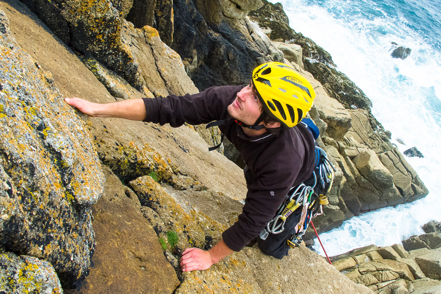 Man rock climbing on sea cliffs in Lundy