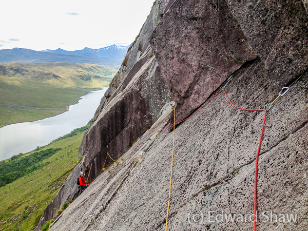 Mike climbing The Hammer HVS 5a on the Etive Slabs